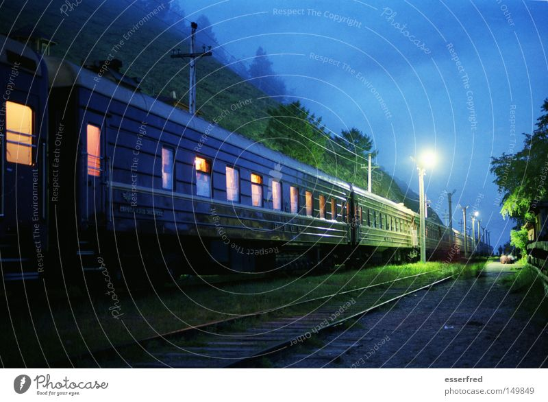 NightTrain Nostalgia Russia Railroad Means of transport Railroad car Railroad tracks Lantern Train window Lighting Evening Blue Mystic Clouds Calm