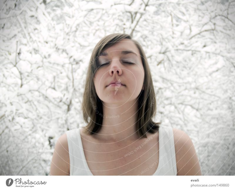 The first fall of snow is a magical event Portrait photograph Woman Closed eyes Snow Tree Branch T-shirt Cold Winter November eyes closed trees
