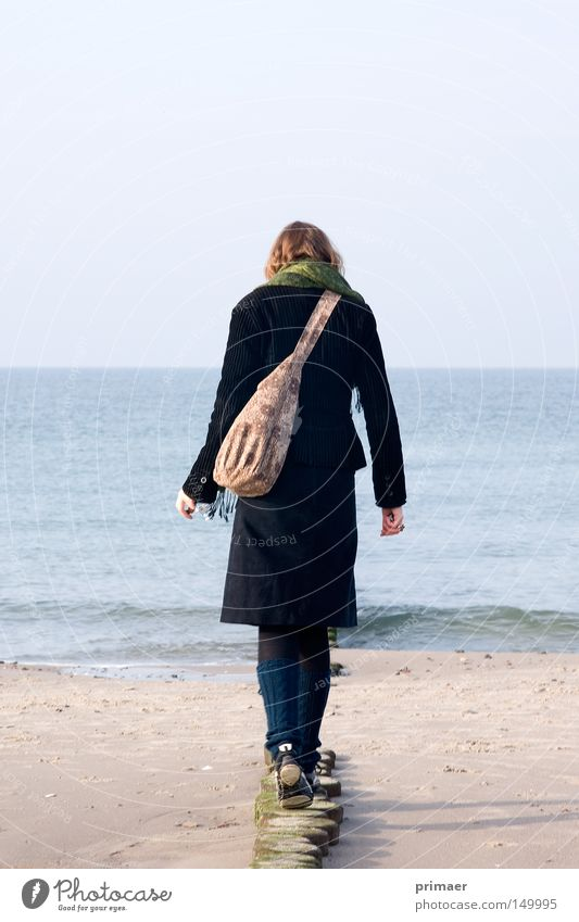 Woman Nature Water Beautiful Sky Ocean Blue Beach Vacation & Travel Calm Loneliness Far-off places Relaxation Autumn Freedom Wood