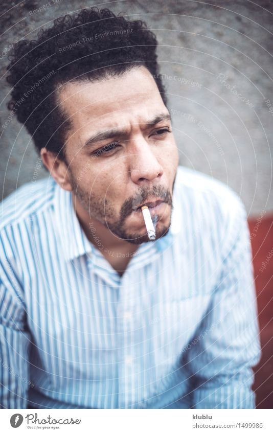 Confident attractive mulatto man smoking a cigarrette Man White Eroticism Black Adults Style Lifestyle Fashion Modern Success Cute Cool (slang) Good Hot