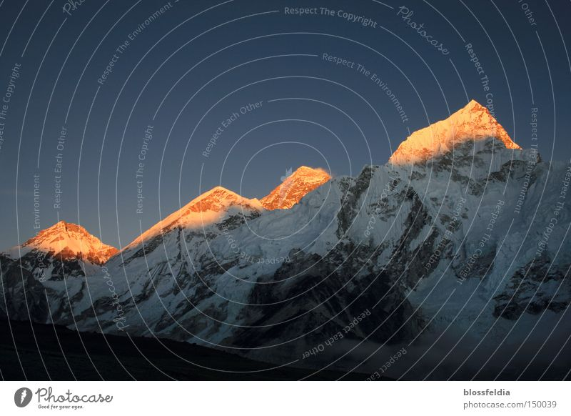 Everest and other mountains Snow Mountain Stone Ice Asia Climbing Tracks Railroad tracks Ascending Sunset To board Nepal Himalayas Climber Tracking