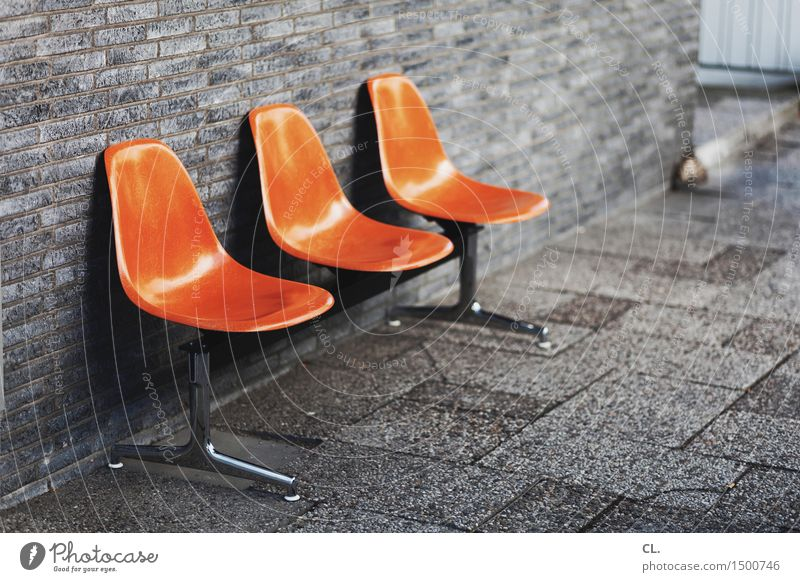 lounge Design Furniture Chair Wall (barrier) Wall (building) Seating Lounges Row of seats Sit Orange Contact Boredom Break Colour photo Exterior shot Deserted