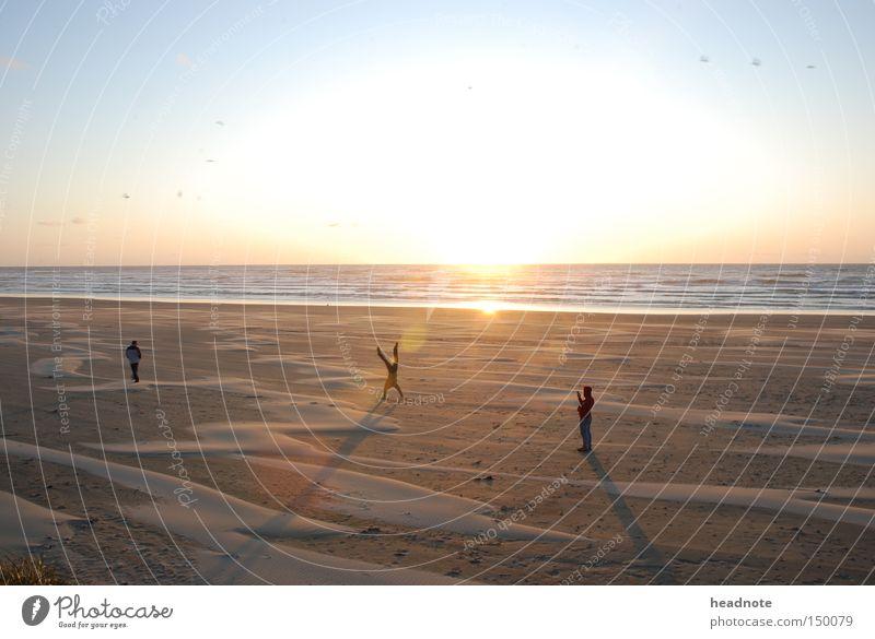 An evening on the beach Beach Human being Sun Sunrise Picturesque Light Shadow Sky Reflection Sand Friendship Ocean Earth Summer