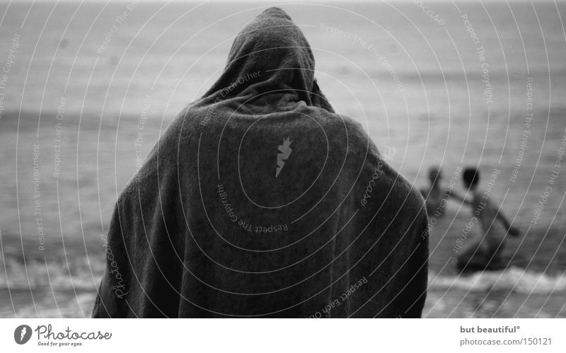 cold times Summer Beach Cold Heat Monk's habit Swimming & Bathing Ocean Towel Mysterious Eerie Coast Black & white photo Observe