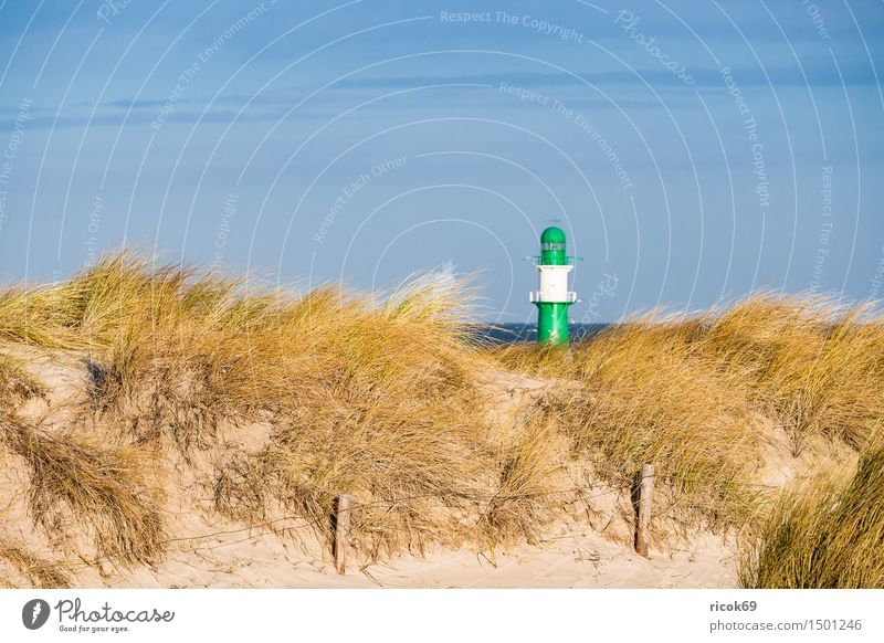 Dune in Warnemünde at the Baltic Sea coast Vacation & Travel Beach Ocean Nature Landscape Clouds Wind Gale Coast Lighthouse Blue Yellow Green Tourism pier light