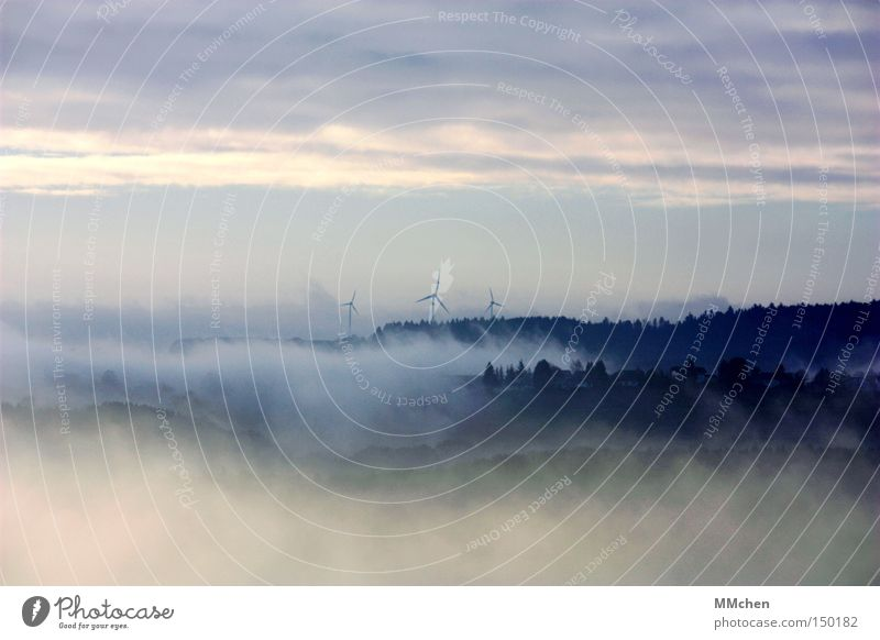On the edge of the world Fog Fog bank Forest Village Settlement Mystic Wind energy plant Eifel Autumn Weather Vantage point Blue Gray Panorama (View) Sky Large