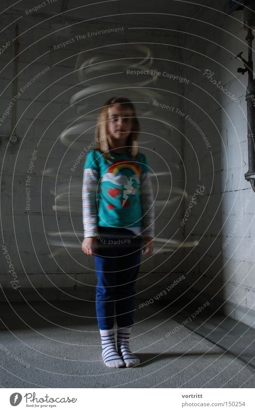 Human being Child Girl Movement Long exposure Clothing Stand Mystic Cellar Rotation Phenomenon Shaft of light Turn back