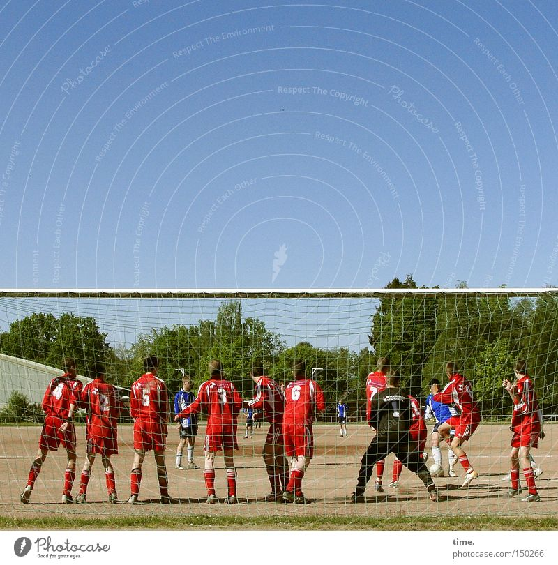 Youth (Young adults) Sports Playing Movement Group Wall (barrier) Soccer Ball Sports team Beautiful weather Playing field Human being Sporting grounds Blue sky Cloudless sky Football pitch