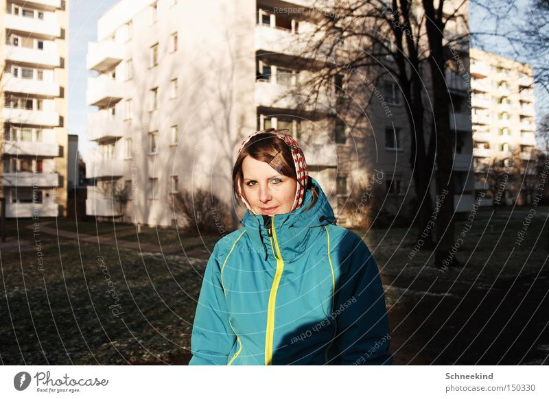 townie Woman Munich House (Residential Structure) Tower block High-rise Winter Cold To go for a walk Shadow Prefab construction pheasant run sunny day