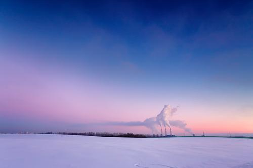 Power plant in the evening Winter Snow Factory Industry Energy industry Landscape Air Sky Sunrise Sunset Meadow Small Town Skyline Building Tube Blue Yellow Red