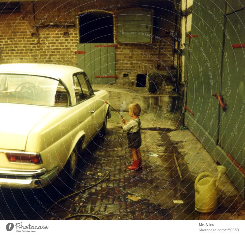 mr.wash Car wash service Vintage car Wet Rubber boots Farm Seventies Joy Motor vehicle Former Nostalgia Self portrait Toddler Water Leather shorts Child