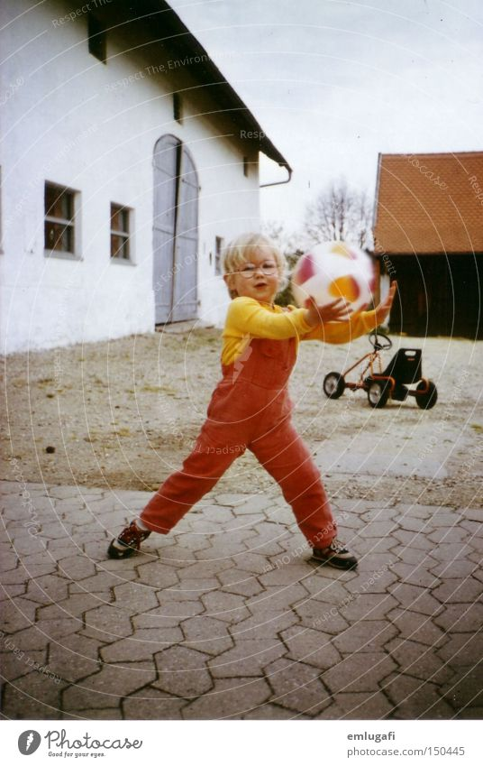 ball game Retro Ball Ball sports Child Infancy Birthday Farm Courtyard Eyeglasses Red Legs apart Action Joy Toddler