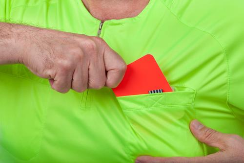Referee takes out a red card from his pocket Sports Soccer Human being Man Adults Hand Shirt Yellow Green Red card sign punishment football penalty official
