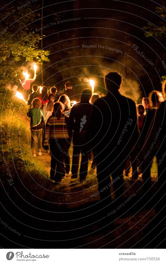 night hike Nocturnal ramble Hiking Torch Youth (Young adults) Fire Dark Forest Fear Panic Group Blaze Spooky
