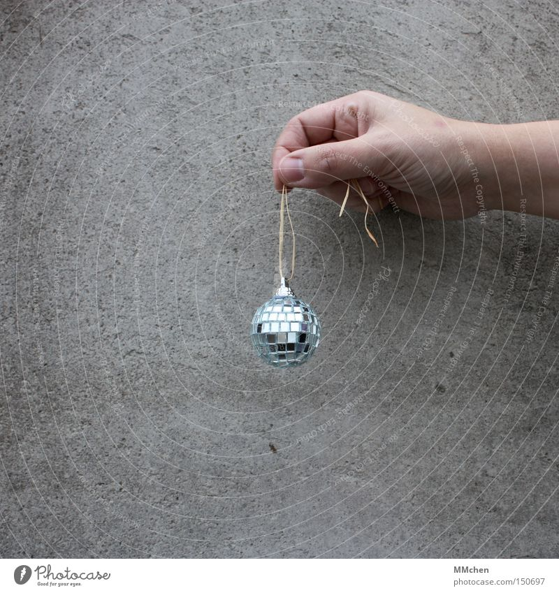 MiniPlaybackShow Concrete Hand Sphere Disco ball Glitter Ball Jewellery Decoration Bright background Isolated Image Copy Space bottom Minimalistic Small