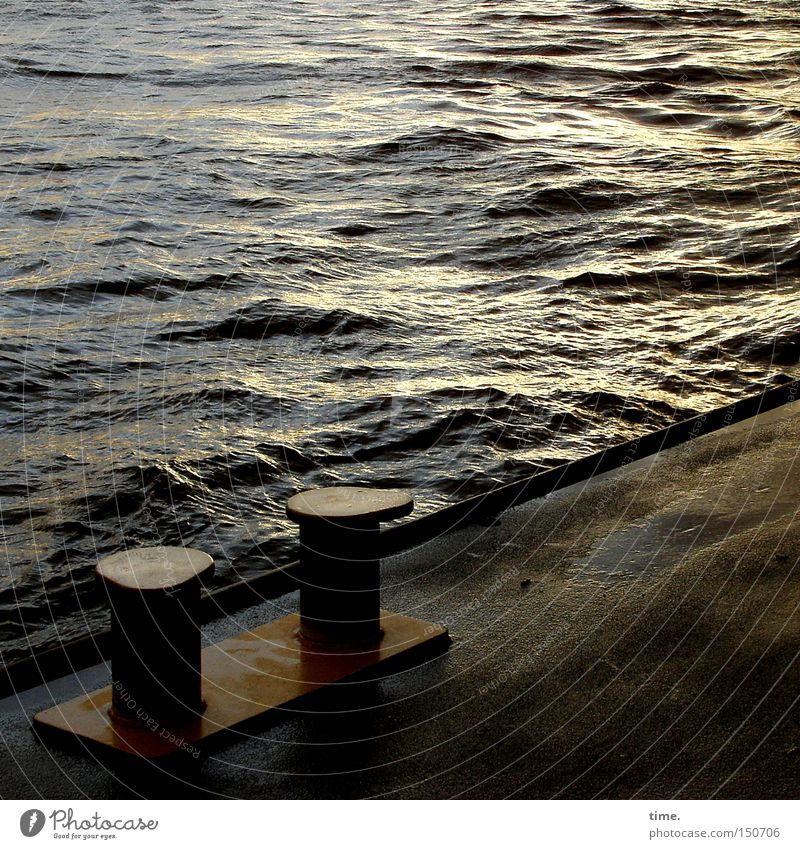 Last light on a cold day Waves Water River Harbour Navigation Sadness Jetty Bollard Asphalt Iron Elbe floating pontoon Evening Reflection Back-light Wet Gloomy
