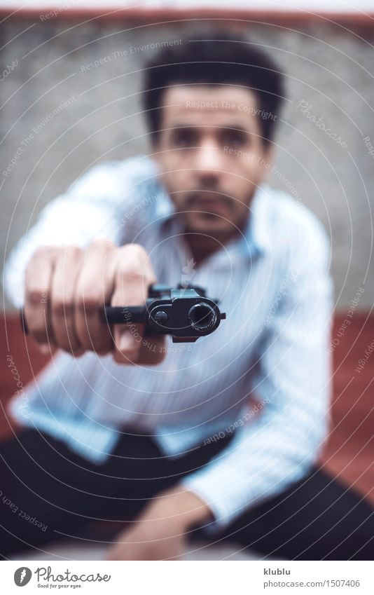 Confident attractive mulatto man with a gun Man Adults Afro Cute Black White Dangerous murderer Weapon shoot Mafia Handgun Kill killer Police Officer Firearm