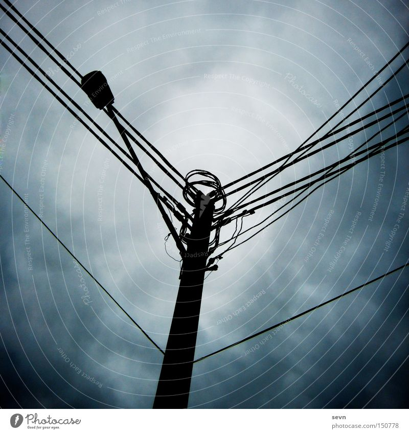 power pole Electricity Electricity pylon Cable Connection Twilight Clouds Dark Thunder and lightning Gale Diagonal Detail Fear Panic Australia Tilt