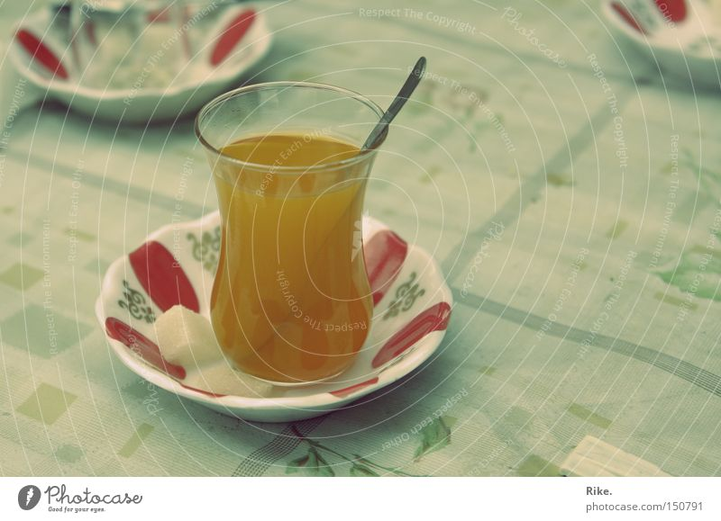 Turkish tea. Tea Turkey Beverage Drinking Hot Delicious Sweet Sugar Near and Middle East Orange Glass Spoon Table To enjoy Thirst Gastronomy Asia Oriental Food