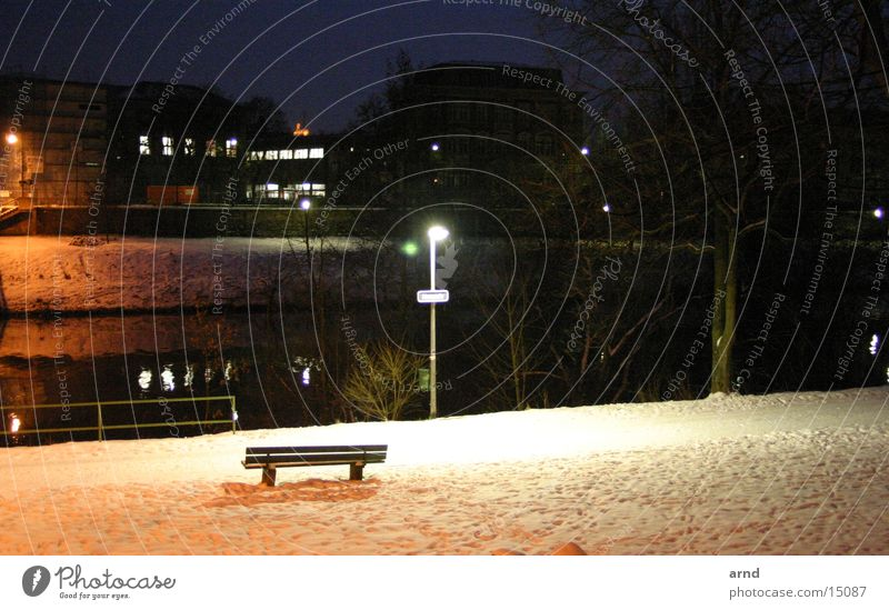 the bank on the river Night Street lighting Park bench Winter Light Dark Loneliness River Snow Coast Bench