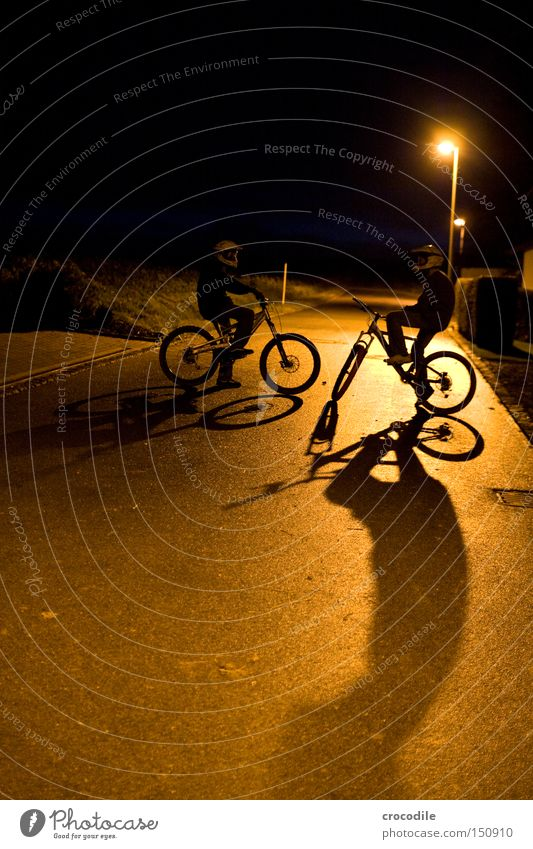 Nightrider ll Motorcyclist Bicycle Sports Helmet Man Twilight Shadow Stand Sit Tire Lantern Success Joy Extreme sports downhill freeride