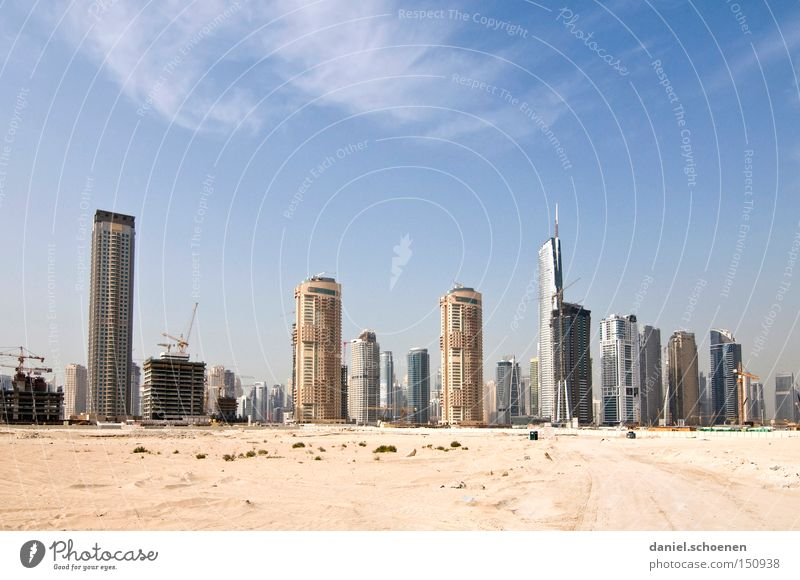 Vacation & Travel Architecture Sand Building High-rise Tourism Construction site Travel photography Desert Skyline Sporting event Competition Near and Middle East Dubai United Arab Emirates
