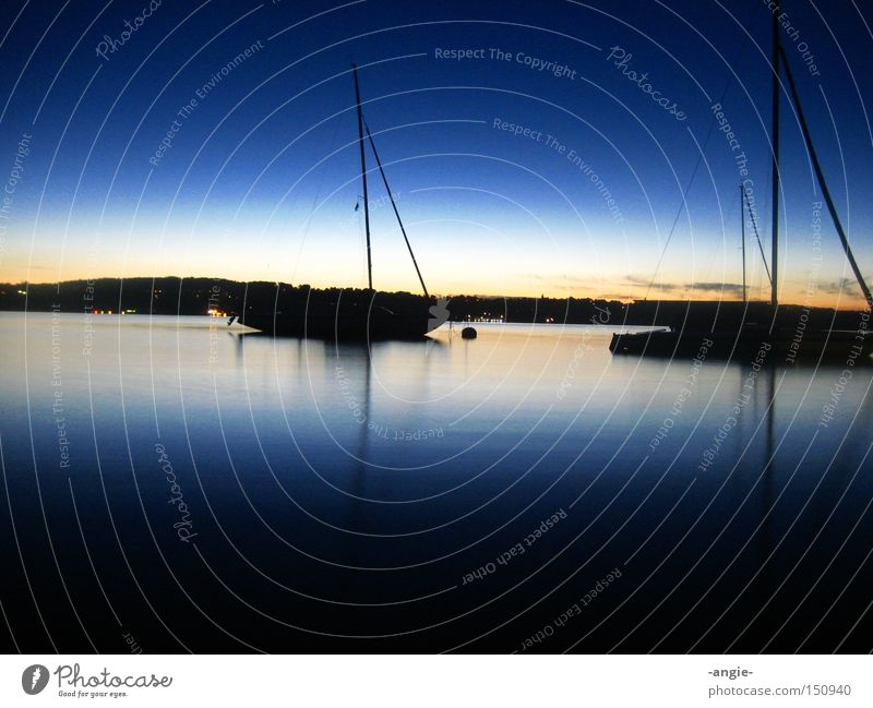 Between day and night Vacation & Travel Sunset Blue sky Long exposure Watercraft Calm Relaxation Romance Night Lake Summer evening Colour great gradient