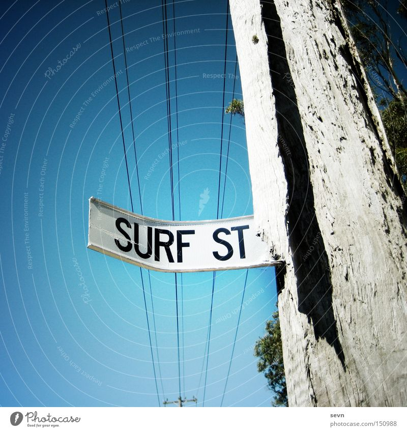Surf Street Surfing Street sign Electricity pylon Tree Signage Signs and labeling Sky Diagonal Broken Aquatics Summer Signpost. sports
