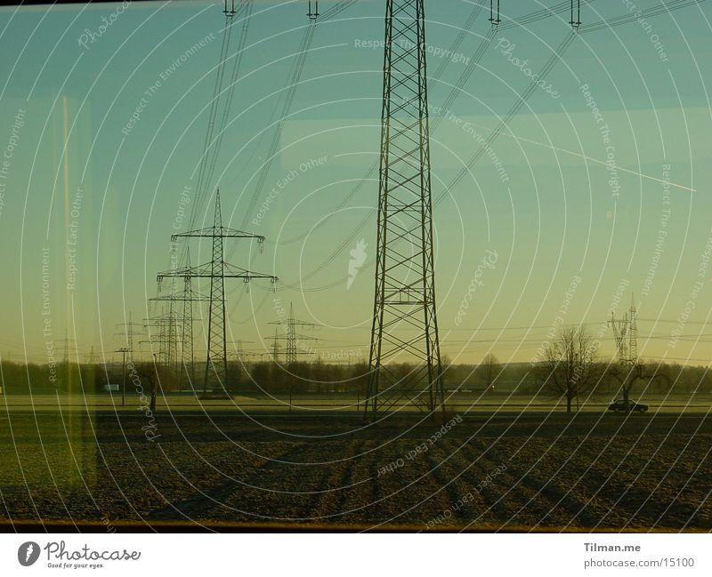 Cold morning Electricity pylon Reflection Transmission lines Train window Transport Sky Fog