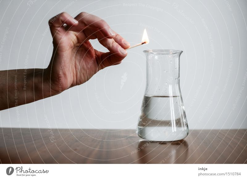 Does it burn?   Experiment Science & Research Experimental Chemistry Hand Match Fuel Erlenmeyer flask Fluid Test tube Glass Threat Curiosity Interest Dangerous