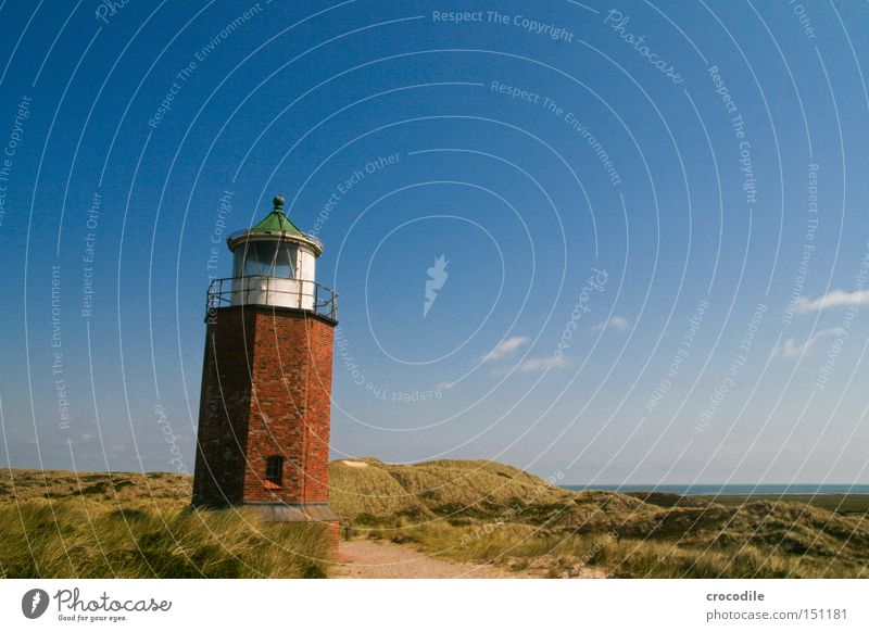 lighthouse North Sea Sylt Lighthouse Tower Brick Beach dune Dune Ocean Warn Navigation Watercraft Captain Sand Landmark Monument Communicate Warning label