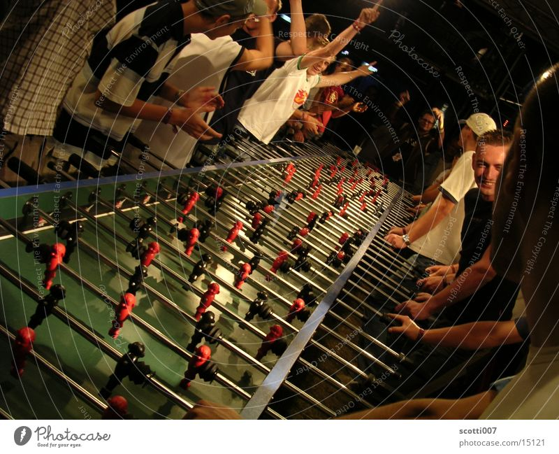Kick it like Beckham Table Long Playing Group Success Joy Goal Applause Elation Central perspective Rod Many Exceptional Colour photo Table soccer