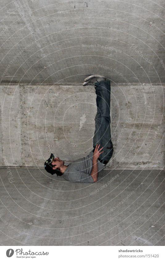 Man Gray Power Concrete Force Construction site Tilt Jeans Column Heavy Acrobatics Pushing Between Concrete wall Spacing