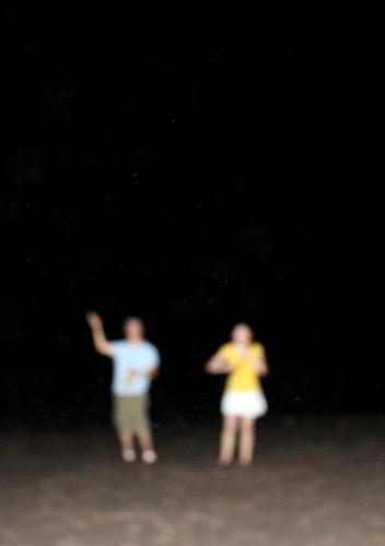 Beach at night Lifestyle Joy Freedom Summer Human being Young woman Youth (Young adults) Young man 2 Sand Night sky Stand Far-off places Happiness Modern