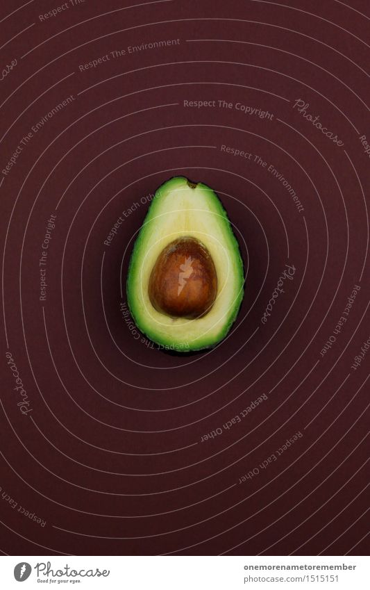 Jammy Avocado on Brown Art Work of art Esthetic Green Healthy Eating Organic produce Kernels & Pits & Stones Pomacious fruits Delicious Nutrition Food Fruit