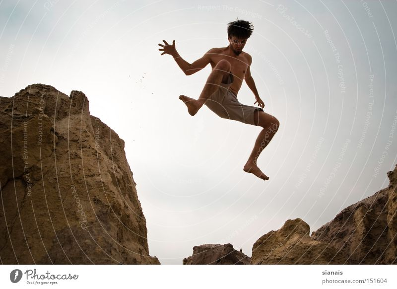 Man Youth (Young adults) Summer Joy Playing Jump Body Rock Action To fall Desert Sudden fall Dynamics Mining Mars Weightlessness