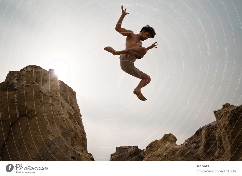 windfall Mars Jump Man Rock To fall Sudden fall Weightlessness Body Action Dynamics Desert Summer Extreme sports Funsport Youth (Young adults) Gravity