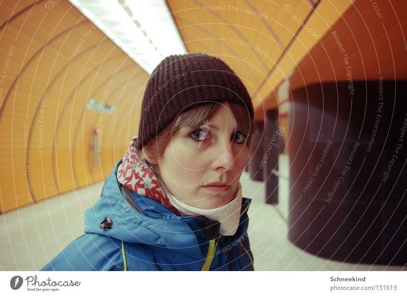 subsoil Underground Subsoil Woman Munich To go for a walk Loneliness Face Railroad Orange Marienplatz