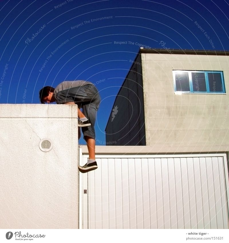 Overcoming borders Leisure and hobbies Human being Man Adults Jeans White Garage Warehouse Extreme Denim Parkour Extreme sports Colour photo Exterior shot Day 1