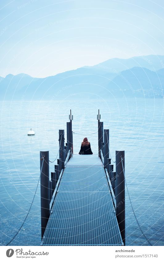 Woman on the jetty Lifestyle Relaxation Leisure and hobbies Vacation & Travel Adventure Ocean Adults Landscape Lake Think Discover Sit Blue Wanderlust