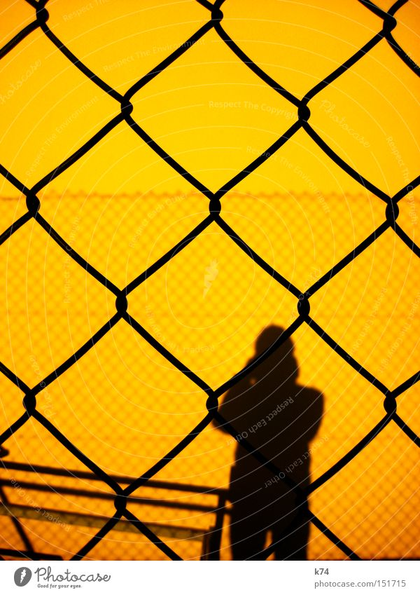 barrier Barrier Hurdle Shadow Human being Man Fence Silhouette Captured Guantanamo Private Border Yellow Penitentiary Fear Panic