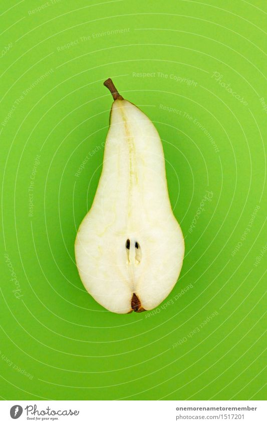 Jammy half pear on green Art Work of art Esthetic Pear Electric bulb Pear stalk Green Healthy Eating Vitamin-rich Division Fruit Delicious Appetite Snack