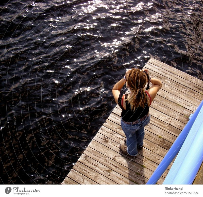 Woman Water Blue Summer Vacation & Travel Ocean Far-off places Relaxation Wood Lake Leisure and hobbies Wet Camera Concentrate Footbridge Sweden