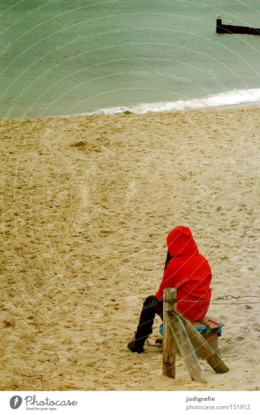 Woman Human being Girl Ocean Red Beach Vacation & Travel Loneliness Colour Cold Autumn Think Sand Coast Rain jacket