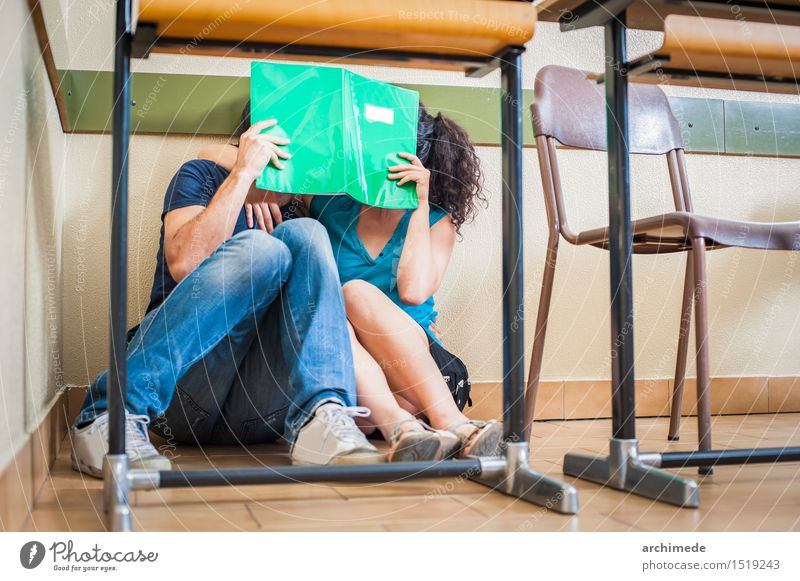 Couple students kissing in classroom Lifestyle Joy Happy Table School Classroom Woman Adults Man Friendship Youth (Young adults) Book Kissing Love Sit Free