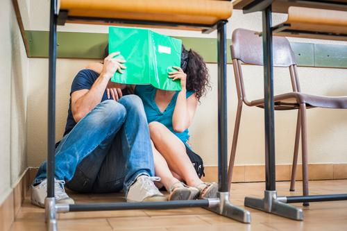 Couple students kissing in classroom Woman Youth (Young adults) Man Joy Adults Love Funny Happy Lifestyle School Together Friendship Free Sit Table