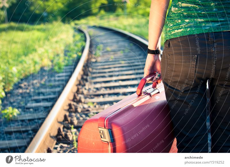 Woman holding luggage on the railroad Lifestyle Vacation & Travel Trip Adventure Adults Hand Street Railroad Discover Free Wild Wanderlust Luggage