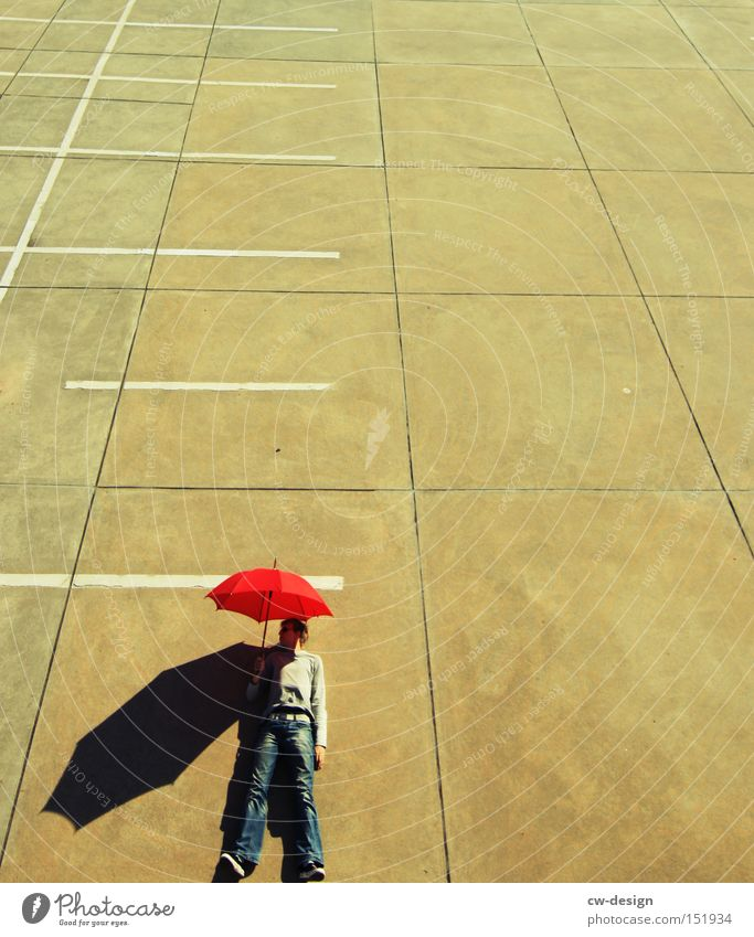 Human being Man Youth (Young adults) Red Joy Leisure and hobbies Lie Masculine Concrete Stand Beautiful weather Umbrella Against Parking lot Parking level