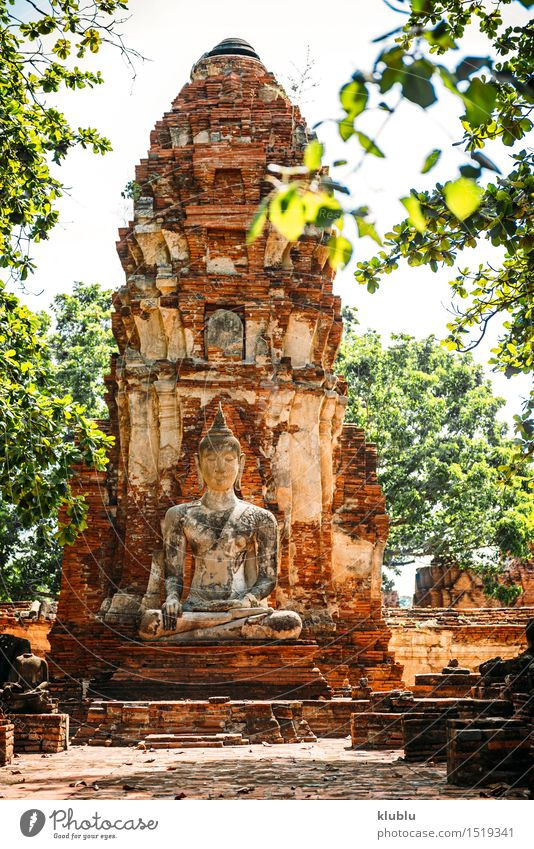 Ancient Buddha statue, in Ayutthaya, Thailand Design Face Meditation Culture Sky Clouds Architecture Old Yellow Belief Religion and faith Asia asian ayothaya