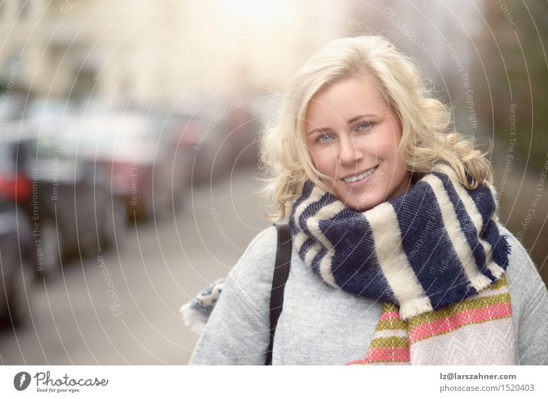 Smiling attractive young blond woman Happy Beautiful Face Feminine Woman Adults 1 Human being 30 - 45 years Street Scarf Blonde Laughter Happiness Alley